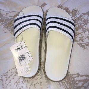 Adidas Adilette Slides.